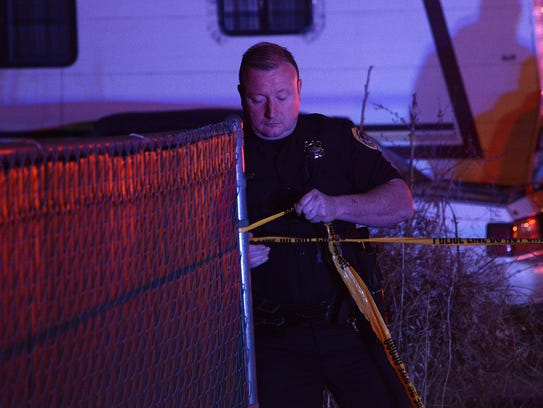 Police investigate a fatal shooting Friday night at