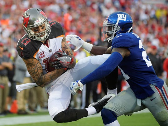 FILE - In this Oct. 1, 2017, file photo, Tampa Bay Buccaneers wide receiver Mike Evans (13) is hit by New York Giants strong safety Landon Collins (21) after a reception during the second quarter of an NFL football game in Tampa, Fla. Evans has agreed to a five-year, $82.5 million contract extension that makes him the second-highest paid receiver in the NFL. The deal confirmed Friday, March 9, 2018,  includes $55 million guaranteed and also makes Evans the highest-paid player with the Buccaneers with an average annual salary of $16.5 million. That's second among NFL receivers behind Antonio Brown's $17 million.(AP Photo/Phelan Ebenhack, File)