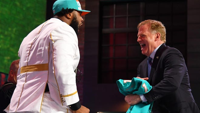 The NFL won't be able to put on a spectacle at the draft this year because of the pandemic, eliminating the possibility of another celebration like last year's involving defensive lineman Christian Wilkins of the Dolphins and NFL Commissioner Roger Goodell.
