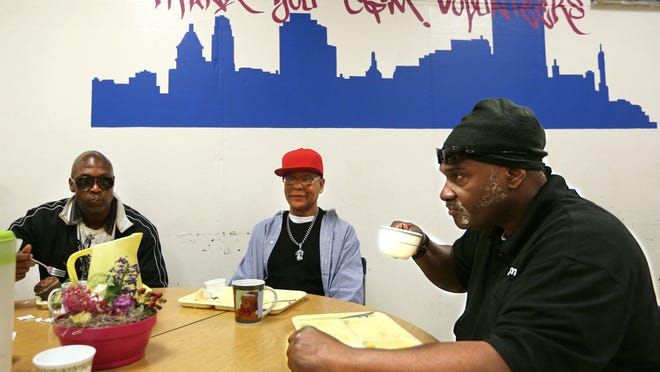 Wednesday, April 23, 2014 Residents of City Gospel Mission in Over-The-Rhine enjoy breakfast early Wednesday morning. (L-R) Kevin Hopgood, Tommy Hughley, and Tony Wilson. They serve about 100 each day for breakfast and dinner.  The Enquirer/ Liz Dufour