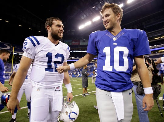Indianapolis Colts' Andrew Luck (12) talks with New York Giants' Eli Manning (10) following a NFL preseason football game Saturday, Aug. 16, 2014, in Indianapolis. The Giants defeated the Colts 27-26. (AP Photo/AJ Mast)