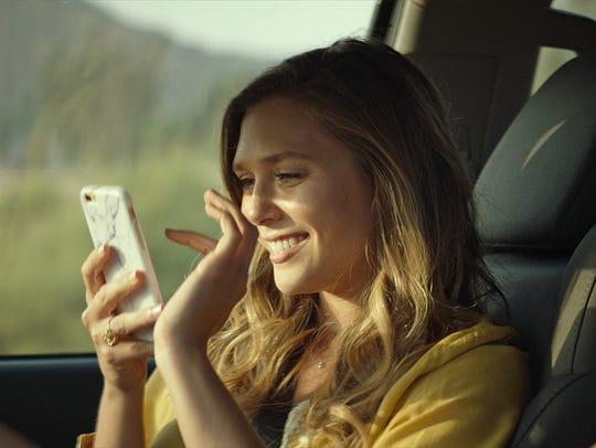 Taylor (Elizabeth Olsen) falls prey to an Instagram