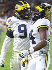 Michigan receiver Josh Metellus, right, and linebacker