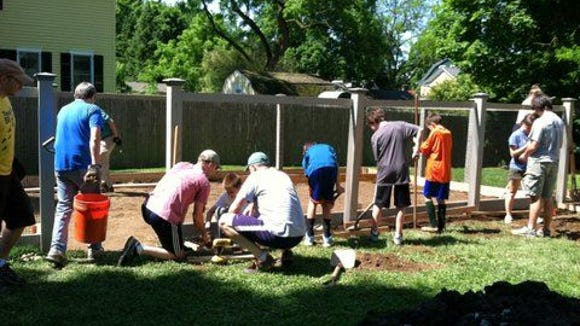 Volunteers plant the new Pleasantville Community Garden