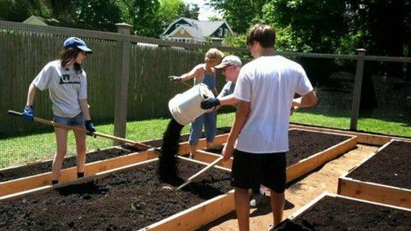 Volunteers plant the new Pleasantville Community Garden -- all