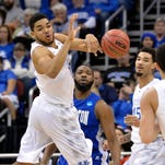 Kentucky's Karl-Anthony Towns (left) passes the ball to Kentucky's Devin Booker during the first half of an NCAA tournament second round college basketball game on Thursday against Hampton in Louisville, Ky.