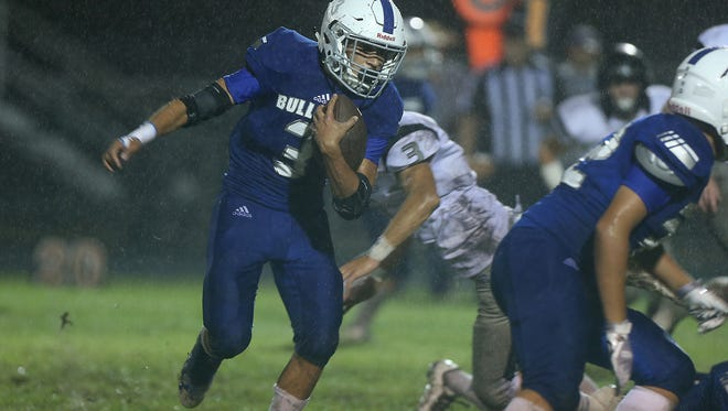 Eden's Donovan Gonzales runs the ball past Water Valley defenders on Sept. 29, 2017, in Eden. Gonzales rushed for 107 yards and a touchdown and returned a punt 54 yards for a TD in the Bulldogs' 32-18 win.