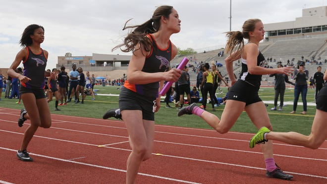 Eastlake's Hailey Black, center, began the final leg of the 4 x 200 competition at the SAC Saturday.