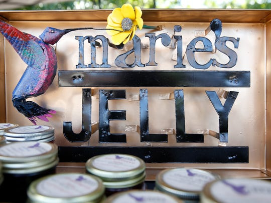 A handcrafted tin sign bring customers in to Rose Garrison's