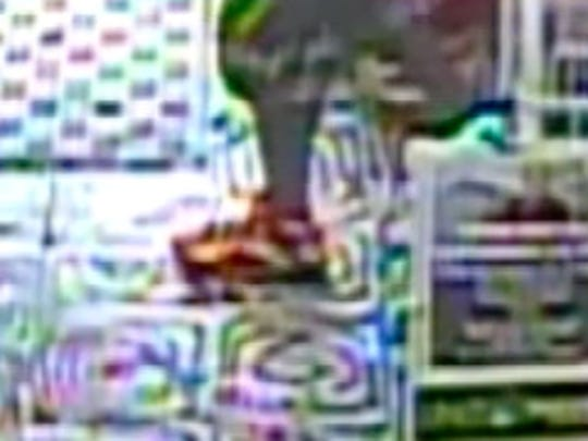 The suspect was described as a 5 foot 9 inch tall thin black male, wearing a black baseball style hat, dark sunglasses, a black and white short-sleeved shirt, black shorts and white/bright orange sneakers.
