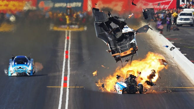 The body blows off John Force's Funny Car at the finish line as he beats Jonnie Lindberg during the Arizona Nationals on Sunday at Wild Horse Pass Motorsports Park. Force was taken to a hospital and released later Sunday.