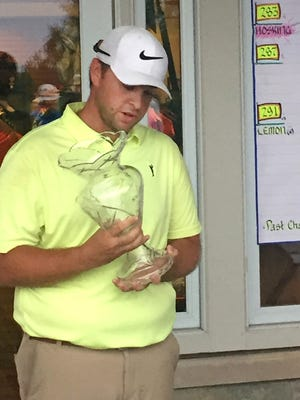 Max Hosking of Madison admires his trophy after winning.