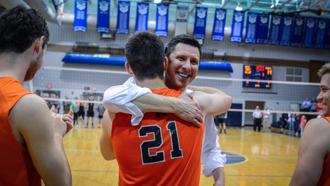 Northeastern head coach Matt Wilson hugs Cole Brillhart while presenting the medals for the York-Adams League boys' volleyball championship, Tuesday, May 15, 2018. John A. Pavoncello photo