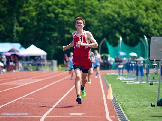 Champlain Valley's Tyler Marshall crosses the finish