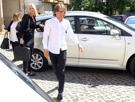 Real Madrid midfielder Luka Modric arrives to the courthouse in Osijek, eastern Croatia, Wednesday, July 5, 2017. Croatia's state attorney has questioned Modric amid accusations that he falsely testified about his financial deals with a former Dinamo Zagreb director charged with embezzlement and tax fraud. (AP Photo)