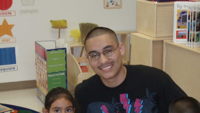 A Tutor Corps student tutors younger children in Immokalee.