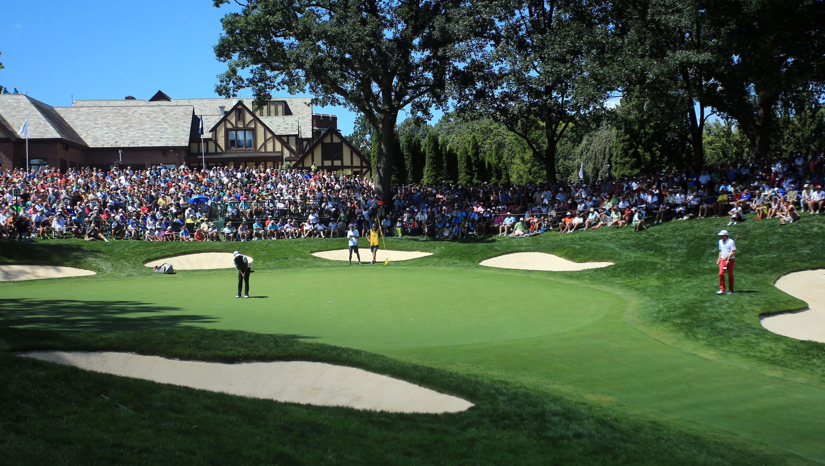 The crowds have been out in force all week at the PGA. Here fans pack in at the 13th green to watch Tiger Woods.