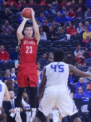 USD's Tyler Flack (23) takes a shot over Fort Wayne's