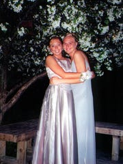 Alaya Serafico, left, and Stephanie Starr share a hug at Sturgeon Bay High School's prom in 2000. They were killed that fall when their car collided with a train in De Pere.