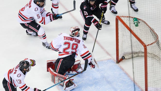 Nebraska-Omaha goalie Kirk Thompson (29) can only watch as St. Cloud State's David Morley (13) scores the game-winning goal in the second overtime in Game 1 of the NCHC playoff series Friday at CenturyLink Center in Omaha, Nebraska.