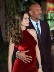 Lauren Hashian and Dwayne Johnson attend the premiere