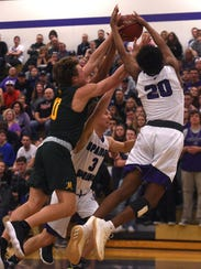 Spanish Springs' Cordell Stinson (20) fights for a