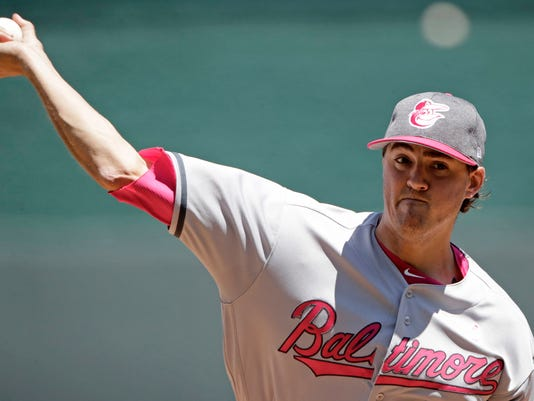 Baltimore Orioles starting pitcher Kevin Gausman throws during the first inning of a baseball game against the Kansas City Royals, Sunday, May 14, 2017, in Kansas City, Mo. (AP Photo/Charlie Riedel)