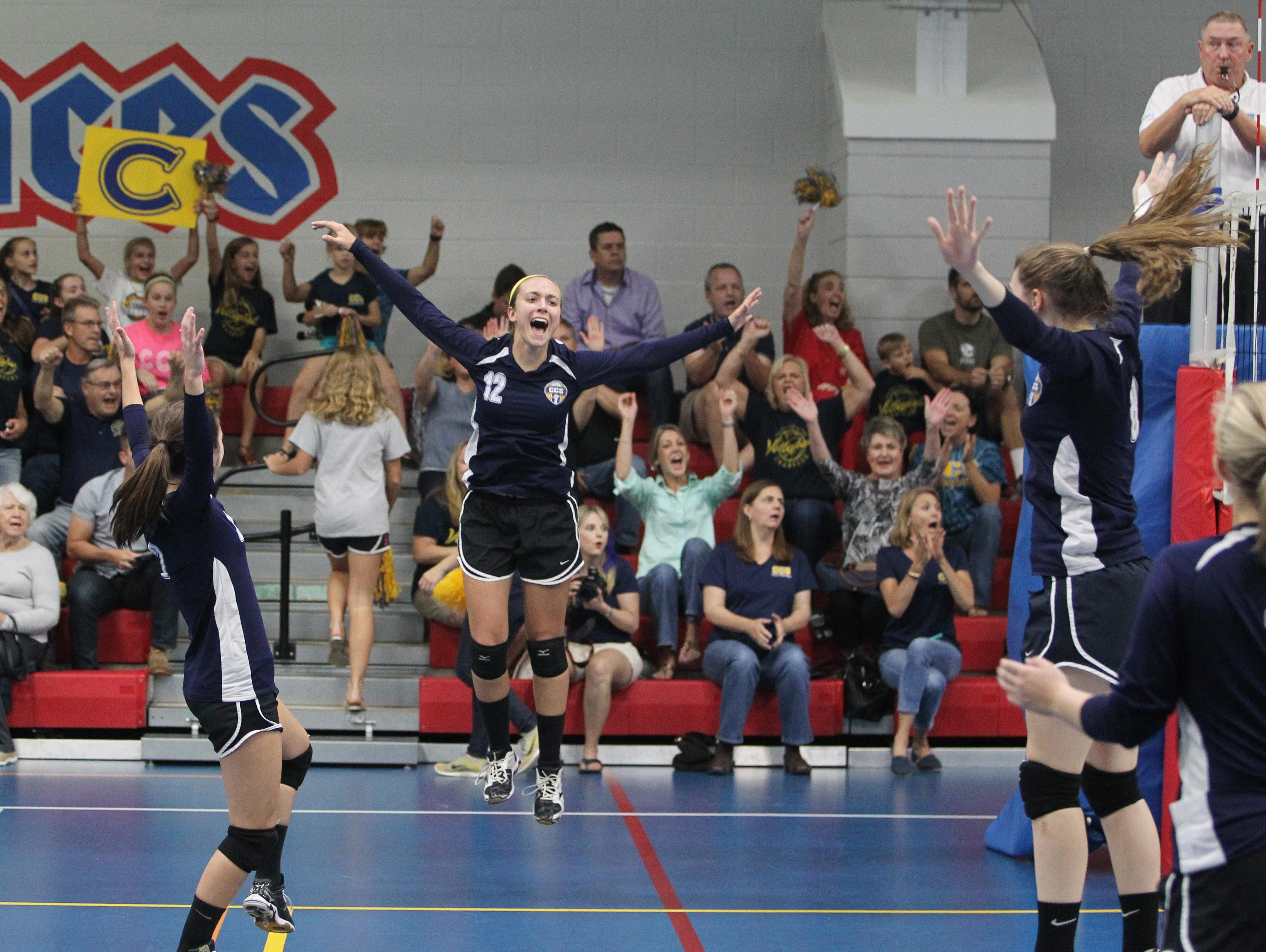 CCS sophomore Abbie Post and teammates celebrate winning a point in a Region 1-2A quarterfinal playoff game against Christ's Church Academy.
