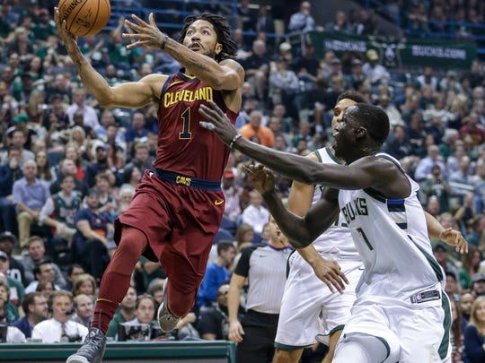 Milwaukee Bucks' Thon Maker, right, defends against a driving Cleveland Cavaliers' Derrick Rose during the first half of an NBA basketball game Friday, Oct. 20, 2017, in Milwaukee. (AP Photo/Tom Lynn)