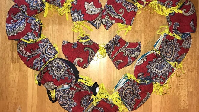 The Morris family of Carver, whose son goes to Sacred Heart, donated 100 hand-sewn masks to Bay State Community Services.