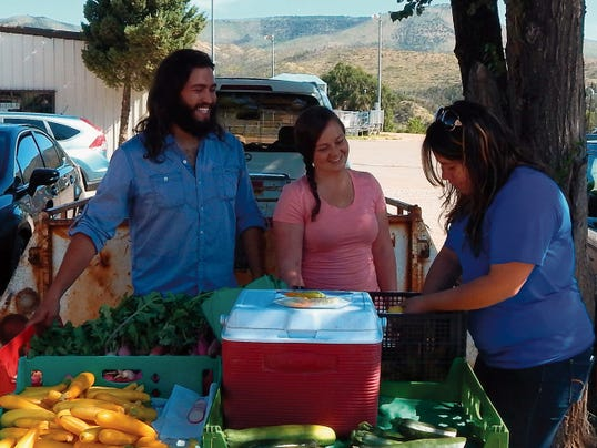 Isaiah Salas and Teresa Korce selling produce from the Hondo Valley at the Ruidoso Downs Farmers' Market.