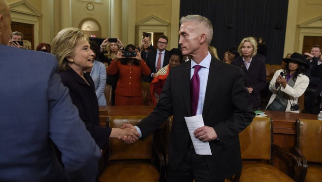 Former secretary of State Hillary Clinton shakes hands with Rep. Trey Gowdy after the Benghazi hearing on Oct. 22, 2015, in Washington.