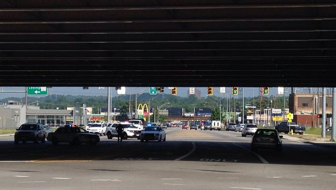 Mitchell Avenue at the I-75 overpass where a man fell to street level. Police are investigating the cause of the fall.