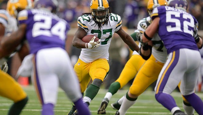 Green Bay Packers running back Eddie Lacy gains yardage against the Minnesota Vikings during Sunday's game at TCF Bank Stadium in Minneapolis.