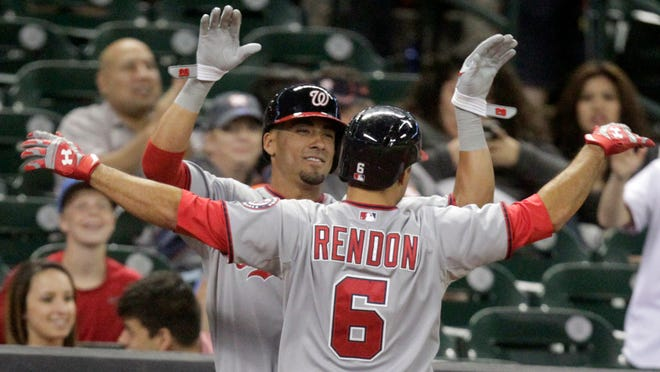 Washington Nationals Anthony Rendon (6) is congratulated by teammate Ian Desmond after hitting a solo home run during the sixth inning.