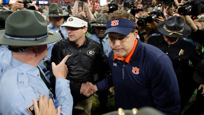 Auburn head coach Gus Malzahn, right, greets Georgia head coach Kirby Smart after Georgia defeated Auburn 28-7 in the SEC Championship Football Game at the Mercedes-Benz Stadium in Atlanta, GA., in Saturday, Dec. 2, 2017.