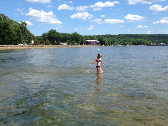 Testing the waters at a beach on St. Albans Bay, July,