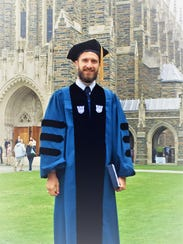 Aaron Forbis-Stokes celebrates his graduation from
