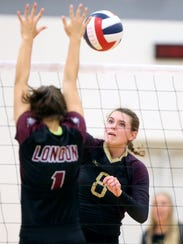 Tuloso-Midway's Katelyn Rozypal hits the ball against