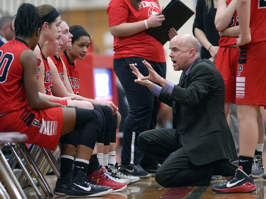 Penfield girls basketball coach Mark Vogt, right, has three daughters who have played varsity sports for Gananda and one more, Maya, 12, who enjoys gymnastics, cheerleading and theater.