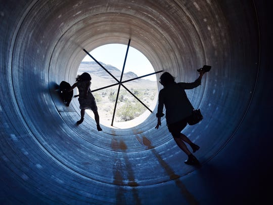 People walk through a Hyperloop tube after the first