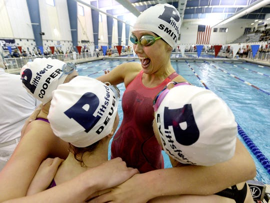 Pittsford's Sarah Smith, facing, celebrates with teammates