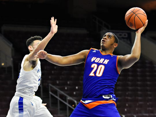 York High's Marquise McClean, right, takes the ball to the hoop while Cedar Crest defends during Court of Dreams game action at Wells Fargo Center in Philadelphia, Friday, Dec. 15, 2017. York High would win the game 55-48. McClean finished with 12 points in the game. Dawn J. Sagert photo