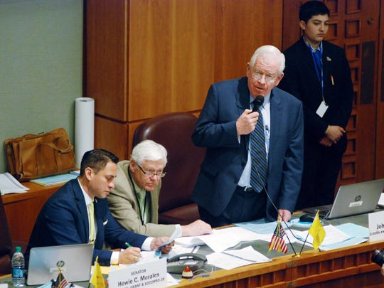 New Mexico state Sen. John Arthur Smith, D-Deming, right, leads a Senate debate on the state budget for the coming fiscal year on Tuesday, Feb. 13, 2018, in Santa Fe, N.M. He was joined by Legislative Finance Committee Director David Abbey, center, and Sen. Howie Morales, D-Silver City, left The Democrat-led Legislature was finalizing provisions of a $6.3 billion budget plan for the coming fiscal year. GOP Gov. Susana Martinez has pushed greater funding to the criminal justice system and has the authority to veto portions or all of the annual budget bill.