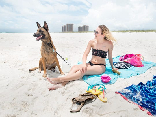 Mallory Cooper and her Belgian Malinois named Aya enjoy the day at the Pensacola Beach Dog Park on May 23, 2018.