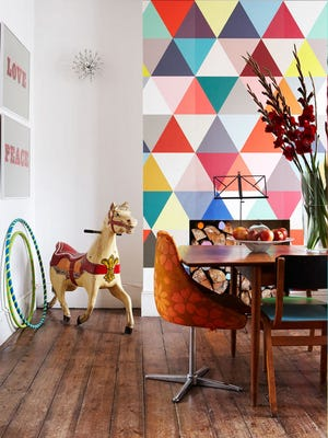 "A triangle feature wall in bold colors by Ashlyn Gibson grabs attention on the cover of her book, ""Creative Family Home."""