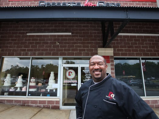 Dana Herbert opens his new bakery, Desserts by Dana, at Red Mill Square, Tuesday. The grand opening is Saturday.