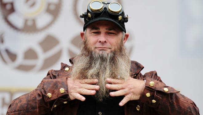 Brian Skeeter Parker runs his fingers through his beard while participating in the Beard and Mustache Competition during the Steampunk and Makers Fair Saturday, November 15, 2014, at Parc Sans Souci in Lafayette, La.