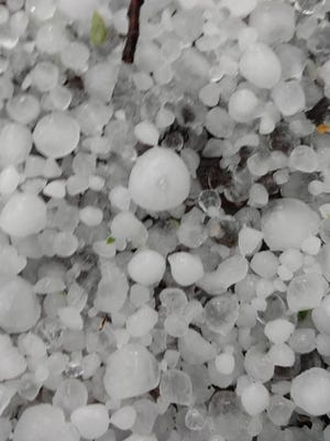 Hail can be seen from a storm.