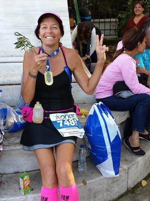 SC4 professor Patricia Frank poses with her medal after completing the Athens Marathon.